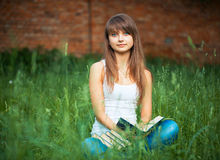 Beautiful girl with book in the park Royalty Free Stock Images