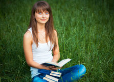 Beautiful girl with book in the park Stock Image