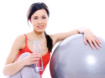 Beautiful girl with bottle of mineral water Stock Photos
