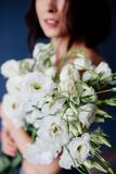Beautiful girl with a bouquet flowers. royalty free stock images