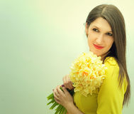 Beautiful girl with a bouquet of flowers Stock Image