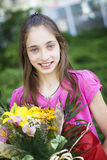 Beautiful girl with bouquet of flowers Royalty Free Stock Images