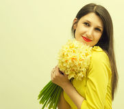 Beautiful girl with a bouquet of flowers Stock Images