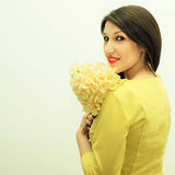 Beautiful girl with a bouquet of flowers Royalty Free Stock Photo