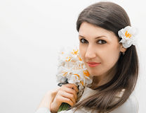 Beautiful girl with a bouquet of flowers Royalty Free Stock Photos