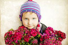 Beautiful girl with a bouquet Stock Photos