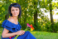 Beautiful girl with a bouquet of gerberas Stock Photos