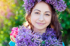 Beautiful girl with a bouquet of lilac in hands walking at spring park Royalty Free Stock Photo