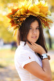 Beautiful girl with a bouquet of maple leaves Stock Photos