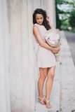 Beautiful girl with a bouquet of peonies near old columns Royalty Free Stock Image