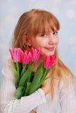 Beautiful girl with bouquet of tulips Royalty Free Stock Images