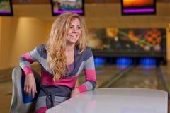 Beautiful girl in bowling Stock Image