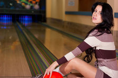 Beautiful girl in bowling Royalty Free Stock Image