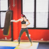 Beautiful girl boxing against punching bag (intentionally blurre Stock Images