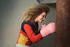 Beautiful Girl in boxing gloves. royalty free stock photo