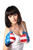 Beautiful girl in boxing gloves. royalty free stock image