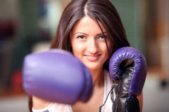 The beautiful girl in boxing gloves Stock Images