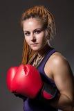 Beautiful girl with boxing gloves, dreadlocks Stock Photo