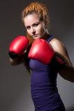 Beautiful girl with boxing gloves, dreadlocks. Stock Photos