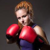 Beautiful girl with boxing gloves, dreadlocks Royalty Free Stock Photos
