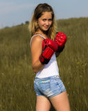 Beautiful girl in boxing gloves Stock Photos
