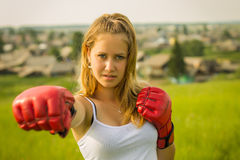 Beautiful girl in boxing gloves Royalty Free Stock Photo