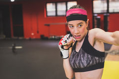Beautiful girl boxing in the gym Stock Image