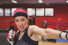 Beautiful girl boxing in the gym Royalty Free Stock Images