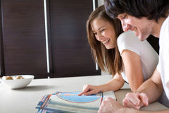Beautiful girl with boy and book Royalty Free Stock Photography
