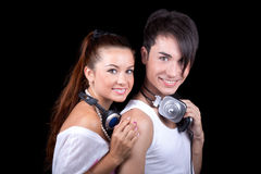 Beautiful girl and boy with headphones. Royalty Free Stock Photography