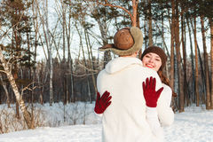 Beautiful girl and boy with husky dog in winter forest Stock Photography