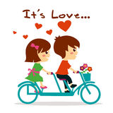 Beautiful girl and boy in love riding bicycle Stock Images