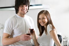 Beautiful girl and boy with wineglasses Stock Image