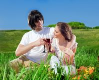 Beautiful girl and boy with wineglasses Royalty Free Stock Images