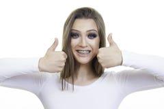 Beautiful girl with brace closeup. Smiling royalty free stock image