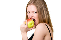 Beautiful girl with brackets eating the apple Stock Images