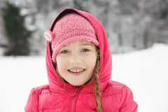 Beautiful girl with braids, enjoying winter and snow Stock Photo
