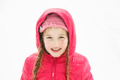 Beautiful girl with braids, enjoying winter and snow stock images