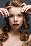 Beautiful girl with braids and gentle makeup. Nude. Beautiful model with bright red lips. Beauty face. The photo was taken in studio Royalty Free Stock Image