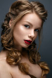 Beautiful girl with braids and gentle makeup. Nude. Beauty model with bright red lips. Royalty Free Stock Image