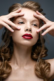 Beautiful girl with braids and gentle makeup. Nude. Beauty model with bright red lips. Royalty Free Stock Photo