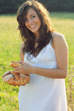 Beautiful girl with bread in hands Stock Image