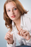 Beautiful girl breaking cigarette. #2. Portrait of beautiful girl breaking cigarette. #2 stock photo