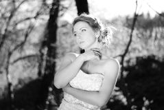 Beautiful girl bride in green wood by summer Royalty Free Stock Photography