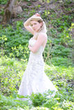 Beautiful girl bride in green wood by summer Stock Image