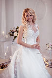 Beautiful girl bride in a magnificent dress. Luxurious light interior Royalty Free Stock Images