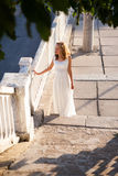 Beautiful girl bride in the sunny old city in the morning Royalty Free Stock Photo