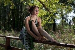 Beautiful girl on the bridge Royalty Free Stock Photo