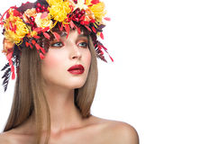 Beautiful girl with bright autumn wreath of. Leaves and flowers. Beauty face. Picture taken in the studio on a white background royalty free stock photos