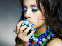 Beautiful girl with bright beads Royalty Free Stock Images